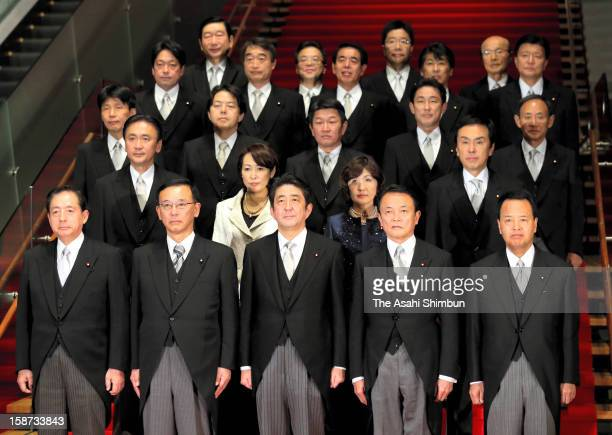 Japan's new Prime Minister Shinzo Abe and his cabinet members pose for photographs at Abe's official residence on December 26 2012 in Tokyo Japan Abe...