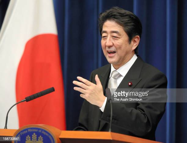 Japan's new Prime Minister Shinzo Abe speaks during a press conference at Abe's official residence on December 26 2012 in Tokyo Japan Abe filled his...