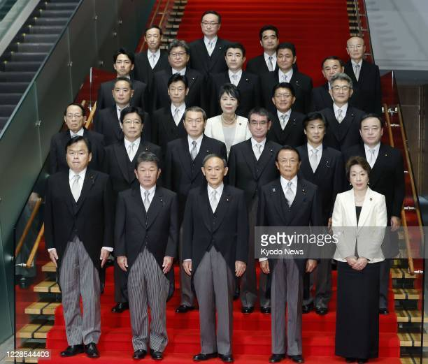 Japan's new Prime Minister Yoshihide Suga and his Cabinet members pose for a photo at his office in Tokyo on Sept 16 2020
