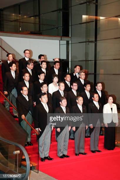Japan's new Prime Minister Yoshihide Suga and his cabinet members pose for photographs at the prime minister's official residence on September 16...