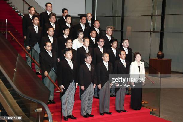 Japan's new Prime Minister Yoshihide Suga poses for a photo with his cabinet members following the first Cabinet meeting at the prime minister's...