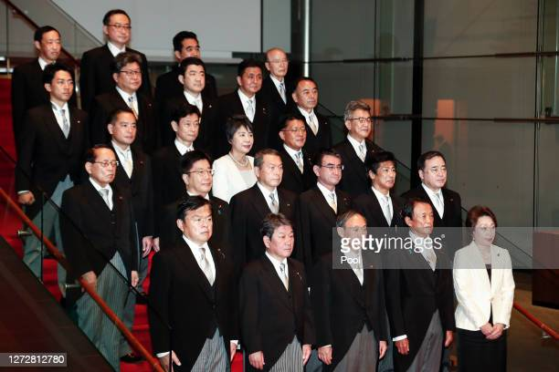 Japan's new Prime Minister Yoshihide Suga poses for the cameras with his cabinet members following the first cabinet meeting at the prime minister's...