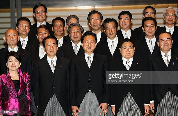 Japan's new Prime Minister Yukio Hatoyama poses for a photo session with his new cabinet ministers at the Imperial Palace on September 16 2009 in...