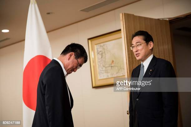 Japan's newly appointed Foreign Minister Taro Kono welcomes former foreign minister and Liberal Democratic Party's Policy Research Council's new...