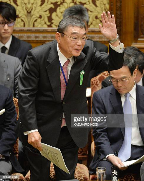 Japan's NHK president Katsuto Momii raises his hand to answer questions during a budget committee session of the House of Representatives at the Diet...