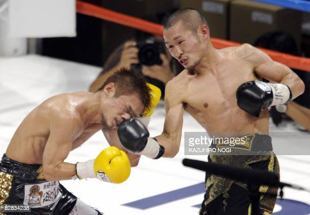 Japan's Nobuo Nashiro connects with a right on the face of compatriot Kohei Kono during their WBA superflyweight title bout in Yokohama Kanagawa...