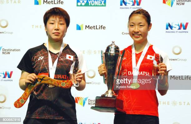Japan's Nozomi Okuhara and Akane Yamaguchi pose after their final match in the women's singles at the World Super Series Australian Open in Sydney on...