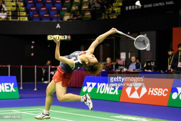 TOPSHOT Japan's Nozomi Okuhara hits a return against Thailand's Ratchanok Intanon during their women's singles final at the Hong Kong Open badminton...