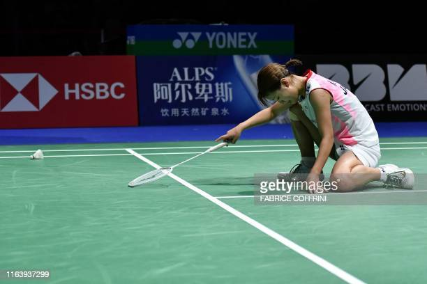 TOPSHOT Japan's Nozomi Okuhara reacts as she returns the shuttlecock to India's Pusarla Venkata Sindhu during their women's singles final match at...