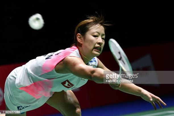Japan's Nozomi Okuhara returns the shuttlecock to India's Pusarla Venkata Sindhu during their women's singles final match at the BWF Badminton World...