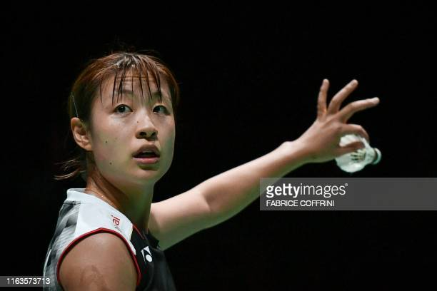 Japan's Nozomi Okuhara serves during her women's singles semi final match against Thailand's Ratchanok Intanon at the BWF Badminton World...