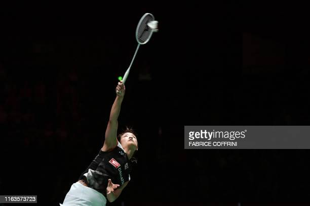 Japan's Nozomi Okuhara serves to Thailand's Ratchanok Intanon during her women's singles semi final match at the BWF Badminton World Championships at...