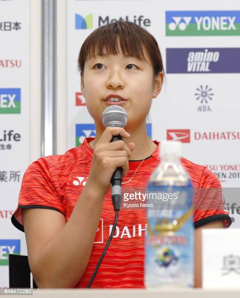 Japan's Nozomi Okuhara speaks about the Japan Open badminton tournament at a press conference in Tokyo on Sept 19 2017 Okuhara who won Japan's maiden...