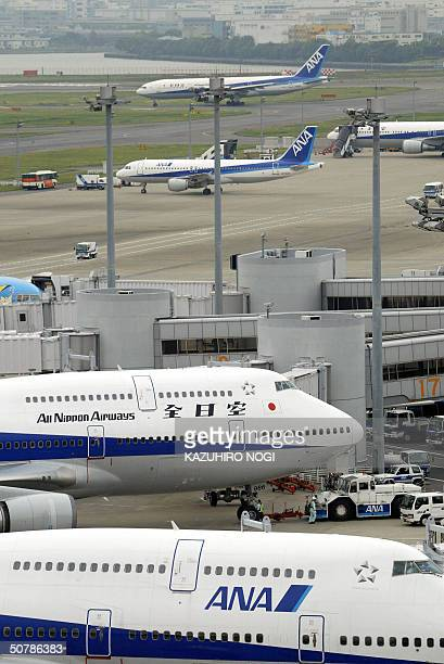 Japan's number two carrier All Nippon Airways jets sit at the tarmac of Tokyo's Haneda Airport 30 April 2004 ANA said it returned to the black in the...
