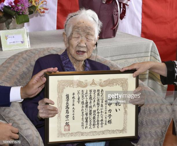 Japan's oldest living female Kane Tanaka poses in Fukuoka on Sept 14 with a certificate of honor given her by the city office Tanaka was born on Jan...