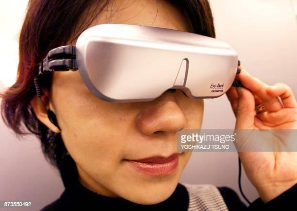 Japan's Olympus Optical employee Yuko Watanabe wears world's lightest headmountdisplay EyeTreak FMD200 weighing 85 grams which enables to display a...
