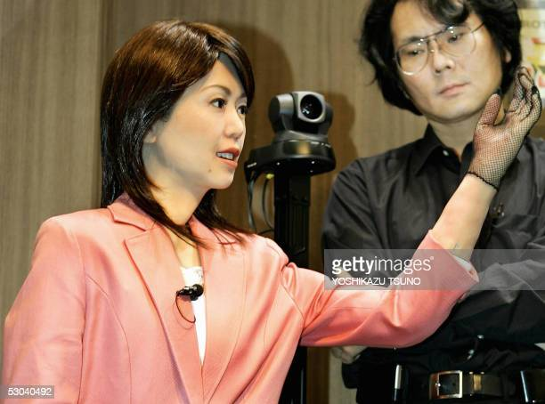 Japan's Osaka University professor Hiroshi Ishiguro checks a humanoid robot 'Actroid Repliee' that looks exactly like a broadcasting newscaster which...