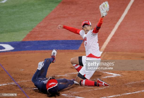 Japan's pitcher Yukiko Ueno appeals tagging out USA's Jannet Reed at home plate during the first inning of the Tokyo 2020 Olympic Games softball gold...