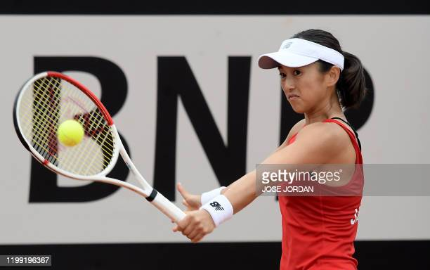 Japan's player Misaki Doi returns the ball to Spain's player Carla Suarez during their Fed Cup Qualifiers first round tennis match between Spain and...