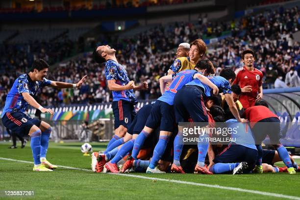 Japan's players celebrate after Australia's defender Aziz Behich scored an own goal during the 2022 Qatar World Cup Asian Qualifiers group B football...
