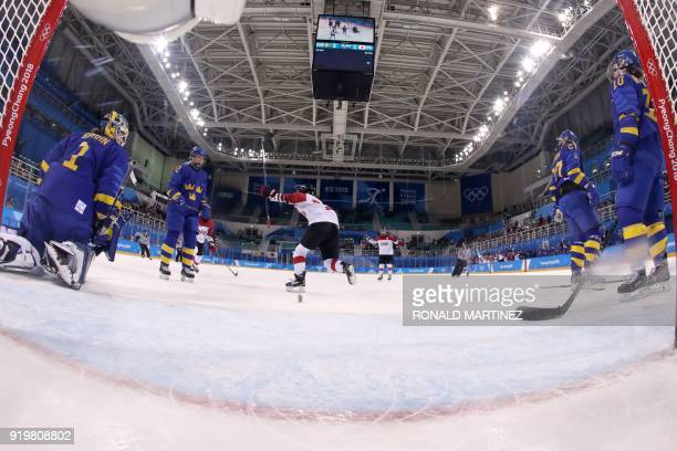 Japan's players celebrate after teammate Japan's Ayaka Toko scored the game winning goal in overtime in the women's classifications ice hockey match...