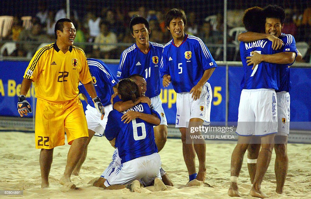 Japan's players celebrate after their victory against Uruguay at the end of their Fifa Beach-Soccer World Cup quarter final match 12 May, 2005 at Copacabana Beach, Rio de Janeiro, Brazil. Japan won 4-3.