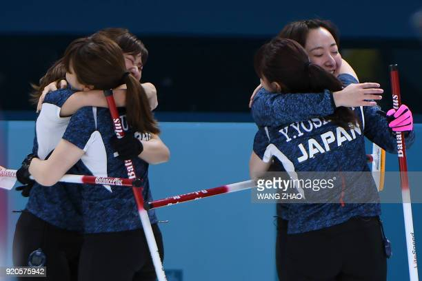 Japan's players celebrate after winning the curling women's round robin session between Japan and Sweden during the Pyeongchang 2018 Winter Olympic...