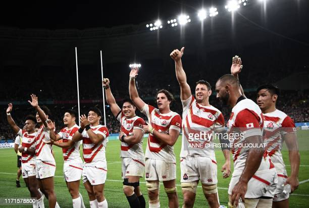 TOPSHOT Japan's players celebrate after winning the Japan 2019 Rugby World Cup Pool A match between Japan and Ireland at the Shizuoka Stadium Ecopa...