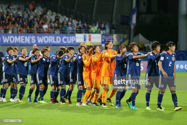 Japan's players celebrate at the start of the podium ceremony during the Women's World Cup Final match between Spain U20 and Japan U20 on August 24...
