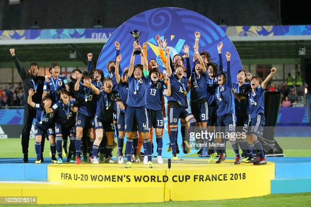 Japan's players celebrate on the podium during the trophy ceremony during the Women's World Cup Final match between Spain U20 and Japan U20 on August...