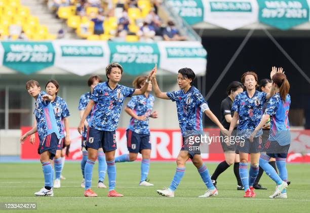 Japan's players celebrate their victory after the women's international friendly football match between Japan and Mexico at Kanseki Stadium Tochigi...