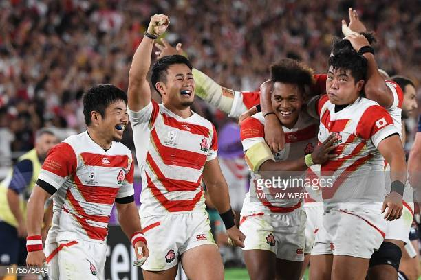 Japan's players celebrate winning the Japan 2019 Rugby World Cup Pool A match between Japan and Scotland at the International Stadium Yokohama in...