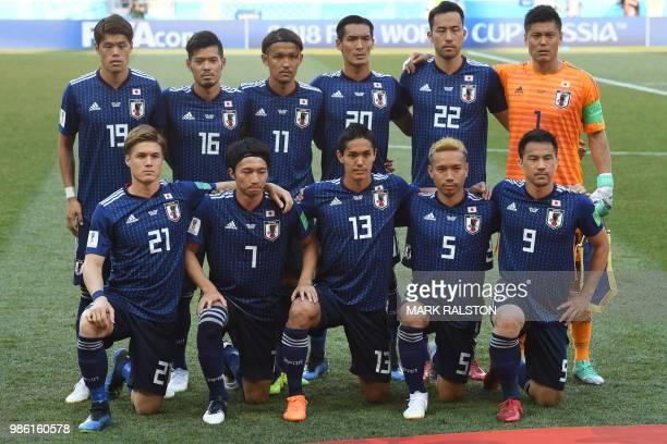 Japan's players defender Hiroki Sakai midfielder Hotaru Yamaguchi forward Takashi Usami defender Tomoaki Makino defender Maya Yoshida goalkeeper Eiji...