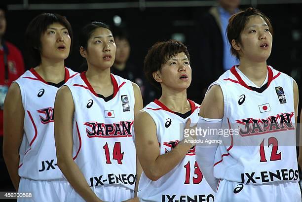 Japan's players Yuki Miyazawa , Yuko Oga and Moeko Nagaoka sing their national anthem ahead of the 2014 FIBA World Championship For Women Group A...