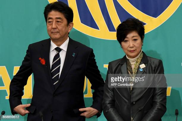 Japan's Prime Minister and President of ruling Liberal Democratic Party Shinzo Abe and Tokyo Governor and head of the Party of Hope Yuriko Koike...