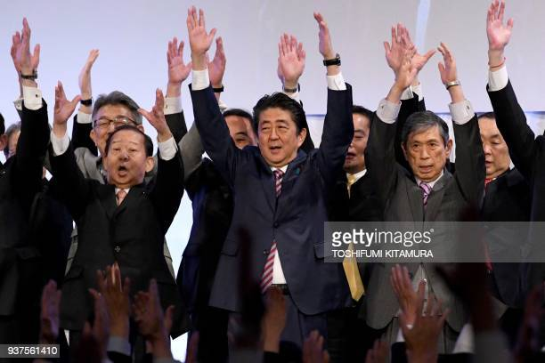 TOPSHOT Japan's Prime Minister and ruling Liberal Democratic Party leader Shinzo Abe leads 'Banzai' shouts at the end of his party convention in...