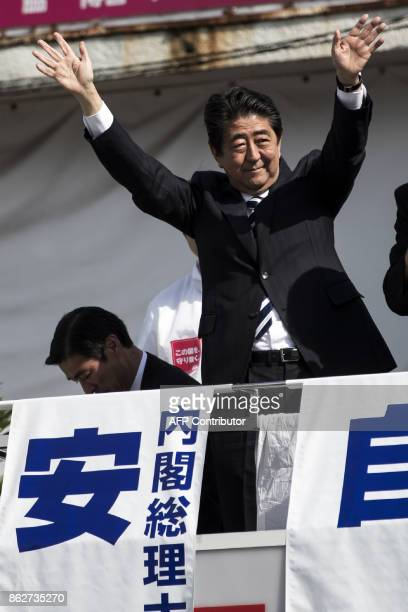 Japan's Prime Minister and ruling Liberal Democratic Party president Shinzo Abe waves to his supporters during an election campaign appearance in...