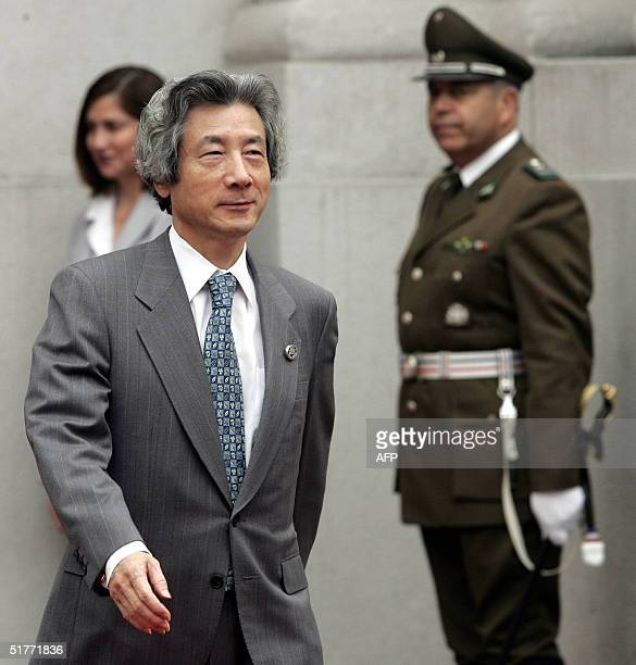 Japan's Prime Minister Junichiro Koizumi arrives at the La Moneda Palace in Santiago Chile 21 November 2004 Koizumi and the leaders of the 21 member...