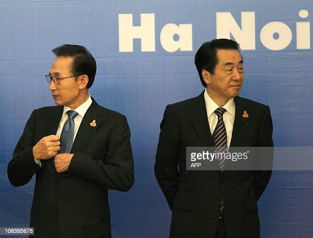 Japan's Prime Minister Naoto Kan and South Korea's President Lee Myungbak attend a group photo for the Association of Southeast Asian Nations summit...