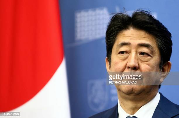 Japan's Prime Minister Shinzo Abe addresses a press conference with his Lithuanian counterpart after their meeting in Vilnius, Lithuania on January...