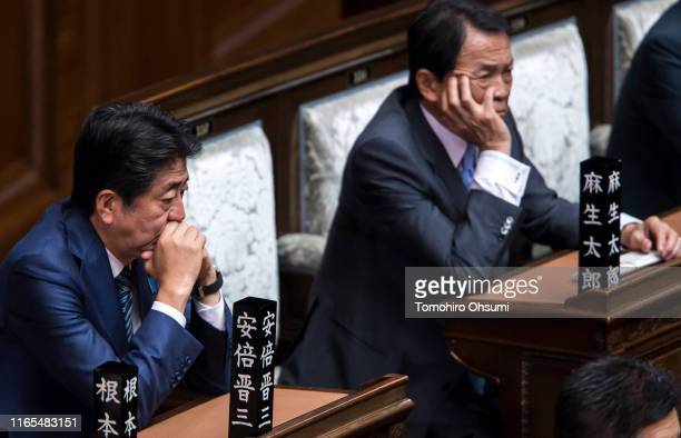Japan's Prime Minister Shinzo Abe and Deputy Prime Minister and Finance Minister Taro Aso attend a plenary session at the lower house of the...