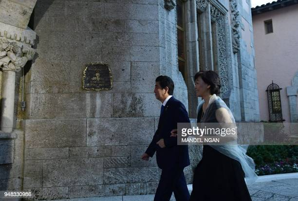 Japan's Prime Minister Shinzo Abe and his wife Akie Abe arrive for a dinner with US President Donald Trump and First Lady Melania Trump at Trump's...