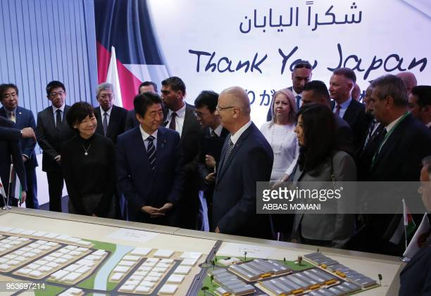 Japan's Prime Minister Shinzo Abe and his wife Akie Abe stand next to Palestinian prime minister Rami Hamdallah and other officials at the Jericho...