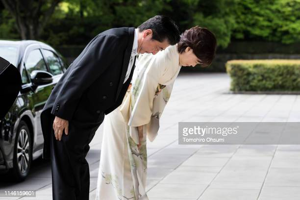 Japan's Prime Minister Shinzo Abe and his wife Akie bow as they arrive for Emperor Naruhito's ceremony for inheriting the Imperial Regalia and Seals...