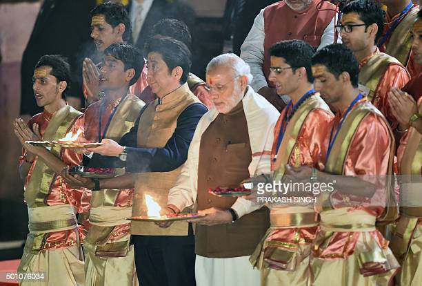 Japan's Prime Minister Shinzo Abe and India's Prime Minister Narendra Modi take part in the evening 'Aarti' ritual on the banks of the River Ganges...