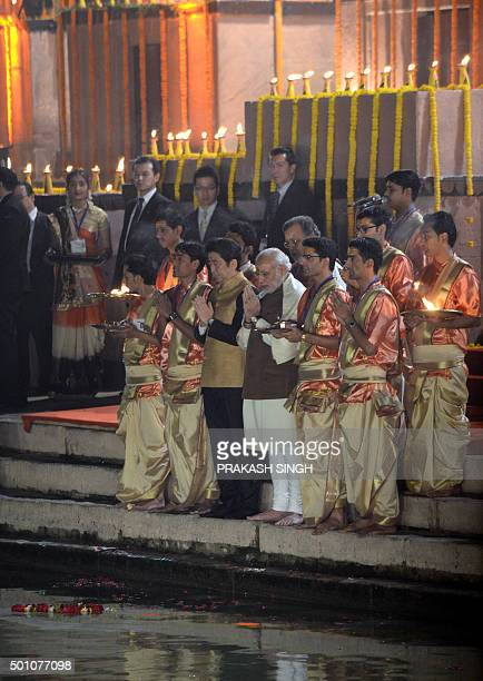 Japan's Prime Minister Shinzo Abe and India's Prime Minister Narendra Modi pray during the evening 'Aarti' ritual on the banks of the River Ganges at...