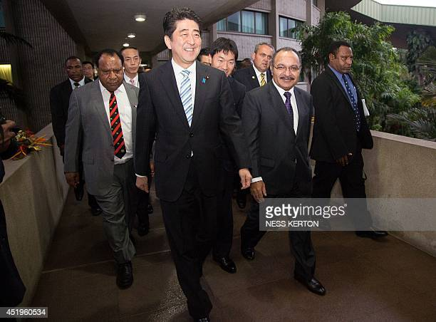 Japan's Prime Minister Shinzo Abe and Papua New Guinea Prime Minister Peter O'Neil walk after a meeting at the Papua New Guinea Parliament in Port...