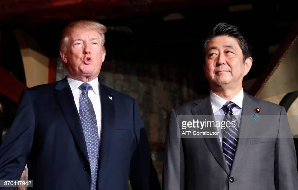 Japan's Prime Minister Shinzo Abe and US President Donald Trump meet for a dinner at a restaurant in Tokyo on November 5 2017 Trump touched down in...