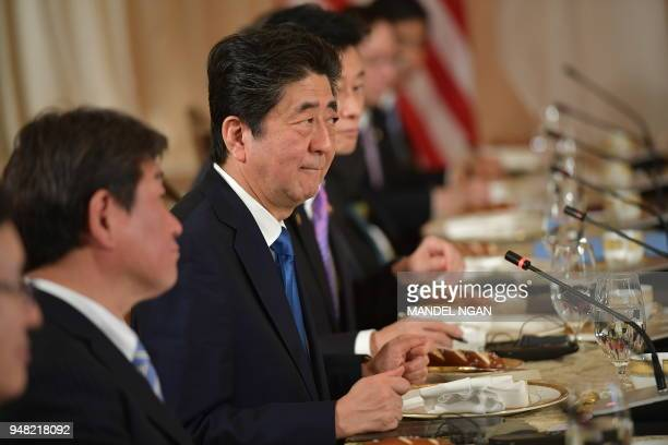 Japan's Prime Minister Shinzo Abe and US President Donald Trumptake part in a working lunch at Trump's Mar-a-Lago estate in Palm Beach, Florida on...