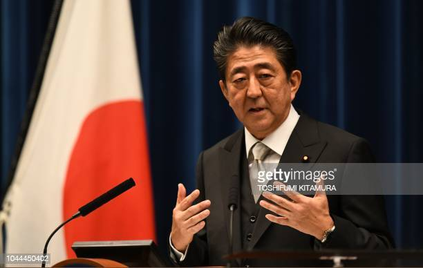Japan's Prime Minister Shinzo Abe answers a question during a press conference following his cabinet reshuffle at the premier's official residence in...